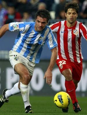 Diego, meia do Atlético de Madri, contra o Málaga (Foto: EFE)