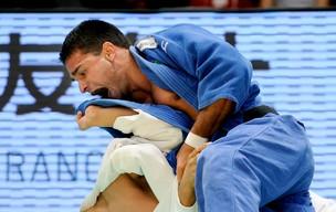 Leandro Guilheiro Grand Slam Toquio contra Takahiro Nakai (Foto: AFP)