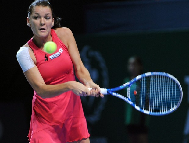 Agnieszka radwanska takes court for her opener at tokyo today (credit