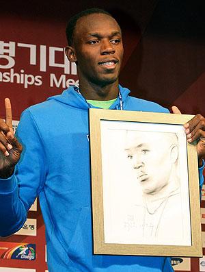 Usain Bolt posa com foto na Coreia do Sul