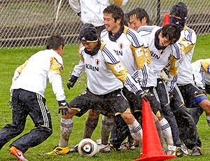 treino Japão chuva