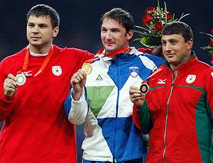 Ivan Tikhon e Vadim Devyatovsky lançamento de martelo medalha em 2008