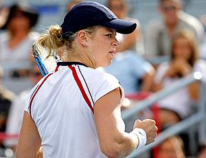 Kim Clijsters comemora vitória no tênis contra Kanepi