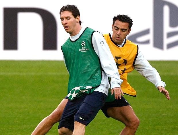 Messi Xavi treino (Foto: Reuters)