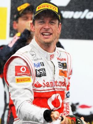 Jenson Button comemora uma de suas duas vitórias em 2011, na Hungria (Foto: Getty Images)