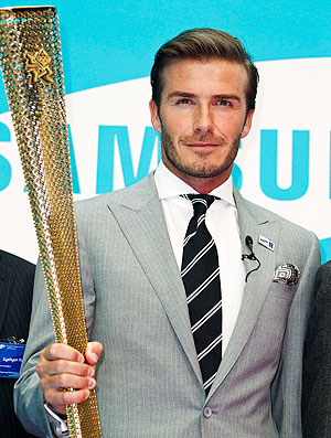 Beckham com a tocha olímpica (Foto: Reuters)