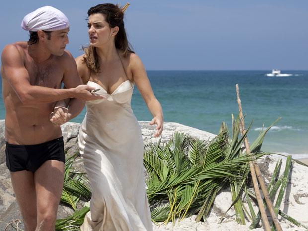 Armandinho impede Desirée dfe ver lancha se aproximando da ilha