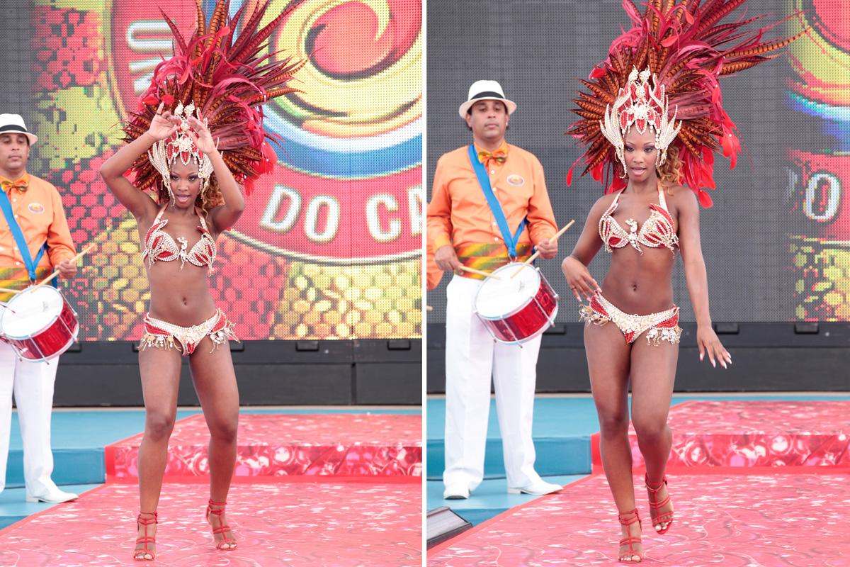Luana inicia sua apresentação sob o olhar mais do que atento do integrante da bateria Unidos do Caldeirão