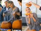 No clima do Halloween, Heidi Klum aprende a decorar abóboras