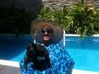 Todo coberto, Belo foge do sol em dia de piscina com Gracyanne