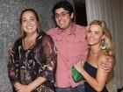 Carol Dieckmann, Claudia Jimenez e Bruno De Luca vão juntos a festa