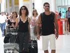 Após término com Laisa, Yuri chega com Claudia Alencar ao aeroporto