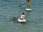 Domingo de sol no Rio leva famosos as praias