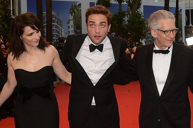 Robert Pattinson entre Juliette Binoche e David Cronenberg (Foto: AFP)