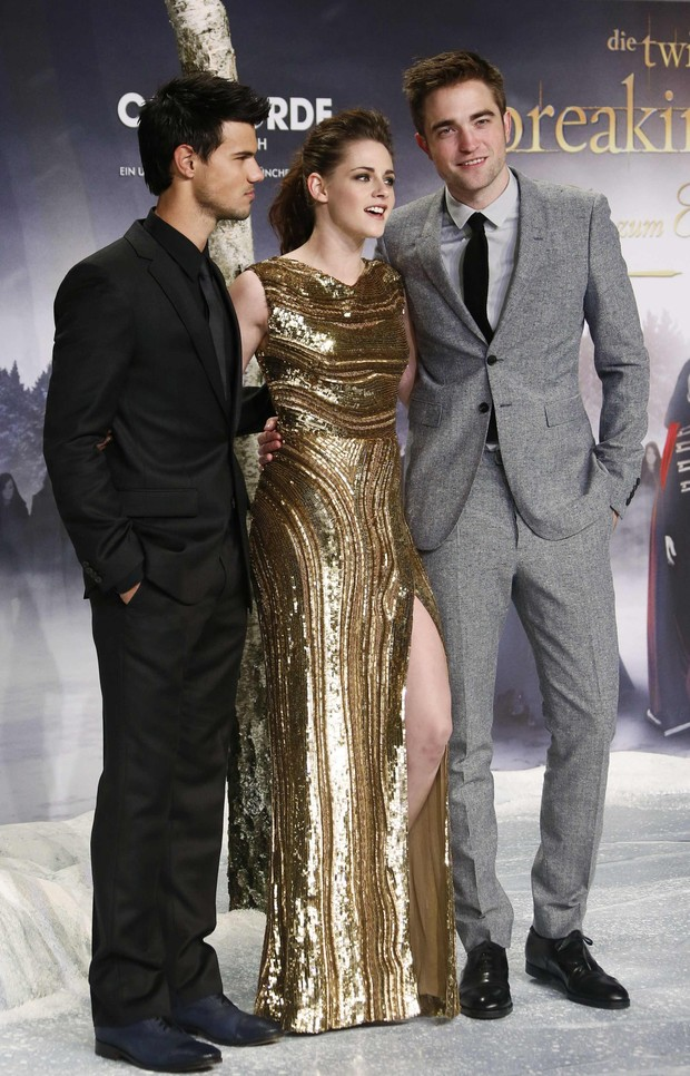 Robert Pattinson,Kristen Stewart e Taylor Lautner em Berlim (Foto: Agência Reuters)