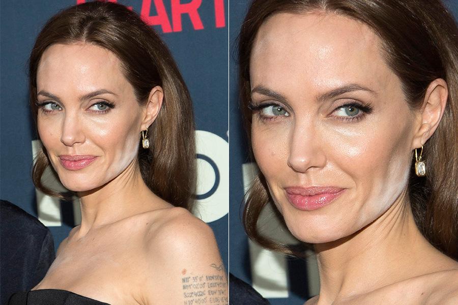 """Na première do filme """"The Normal Heart"""", nesta segunda-feira, 12, em Nova York, Angelina Jolie exagerou no pó e acabou aparecendo com manchas brancas no rosto"""