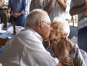 Sebastiana de Oliveira Nates, 82, and Isauro Ferreira Nates, 86, kiss while celebrating 65 years of marriage