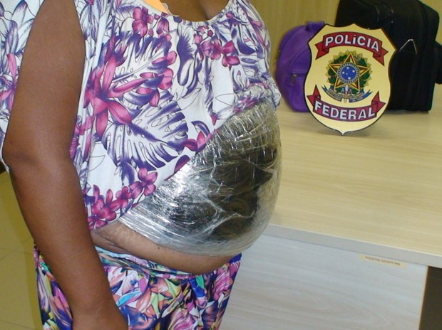 Woman arrested in Brazil with cocaine hidden inside a fake 'baby bump' which made her appear pregnant