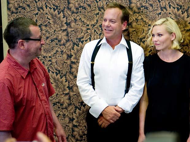 O diretor Lars von Trier e os atores Kiefer Sutherland e Kirsten Dunst durante apresentação do filme 'Melancholia'  na Suécia