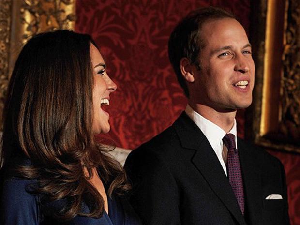 Kate Middleton e o príncipe William sorriem durante o anúncio oficial de seu casamento, no Palácio de St. James, em Londres, nesta terça-feira (16).