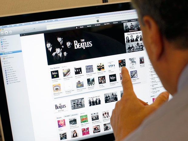 Os Beatles no iTunes: catálogo do grupo foi posto à venda na terça-feira (16), mas álbuns já ocupam parte de cima do ranking da loja de músicas digitais