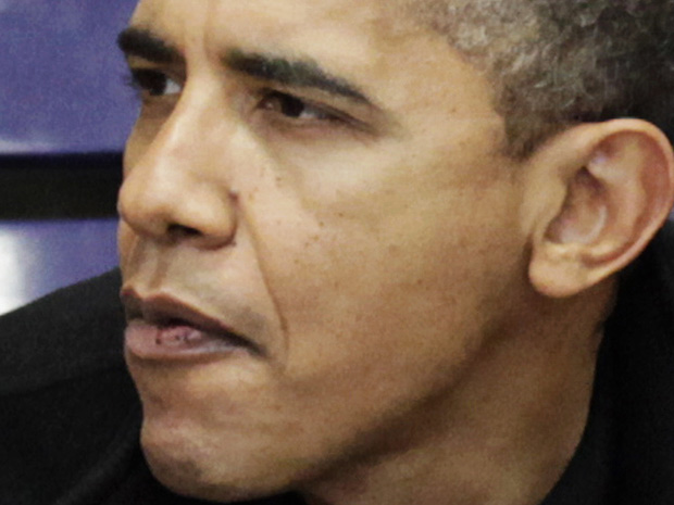O presidente dos EUA, Barack Obama, assiste a jogo de basquete em universidade em Washingon neste sábado (27).
