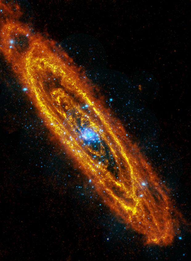 Galáxia de Andrômeda, a mais próxima das Via Láctea, é fotografada por satélites da agência espacial europeia em foto divulgada nesta quarta-feira (5). Os observatórios Herschel e XMM-Newton