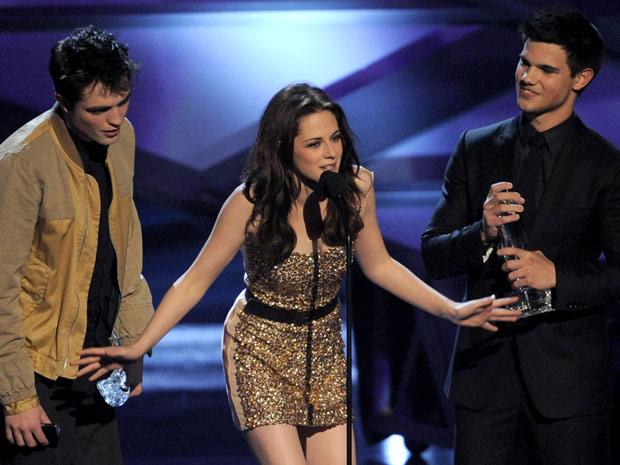 Robert Pattinson, Kristen Stewart e Taylor Lautner da série 'Crepúsculo'