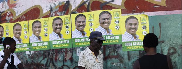 Cartazes da candidatura de Jude Celestin são vistos nas ruas de Porto Príncipe, capital do Haiti, em 20 de janeiro.