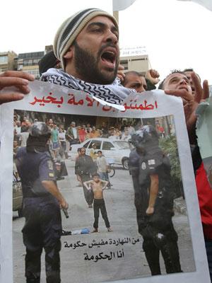 Manifestante Líbano (Foto: Anwar Amro/ AFP)