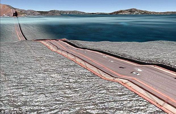 Uma falha na função 3D do Google Earth modificou a famosa ponte Golden Gate, em San Francisco, nos Estados Unidos. As clicar na opção 'construções em 3D', o ponto turístico da cidade parece ter 'derretido', dando a impressão que ela está 'boiando' na água. Essa e outras falhas em pontes foram encontradas pelo programador Clement Valla, que viajou pelo Google Earth para reunir 60 imagens da ferramenta que mostram o que acontece quando a tecnologia 2D e 3D não se adaptam. (Foto: Reprodução/Google Earth)