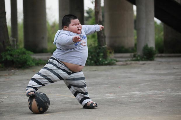 Lu Zhihao tem dificuldades para praticar esportes. (Foto: Joe Tan/Reuters)