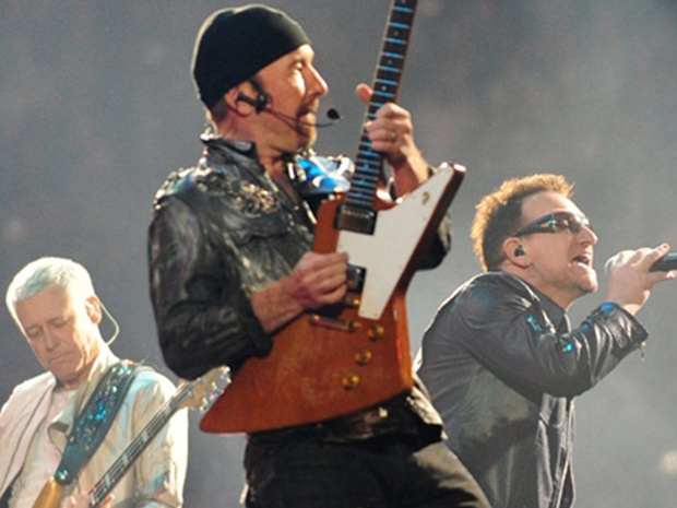 Os integrantes do U2 em show no Chile (Foto: Claudio Santana/AFP)