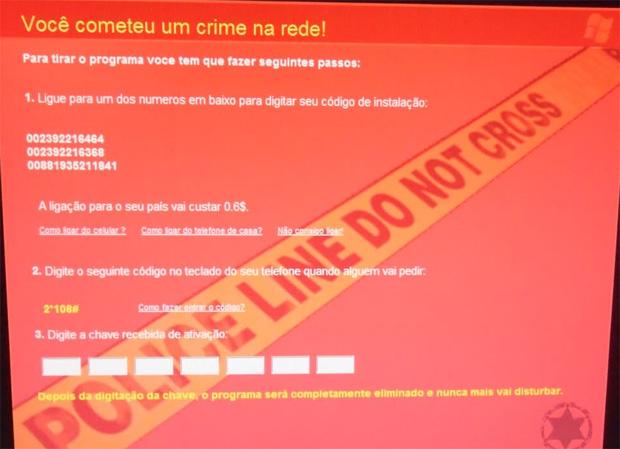 Vírus afirma que usuário deve telefonar para um número e obter o código de destravamento (Foto: Arquivo pessoal/Bráulio Gomes)