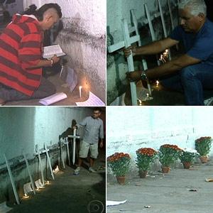 Flores, velas e cruzes em frente à escola atacada em Realengo, na Zona Oeste do Rio (Foto: Reprodução/TV Globo)