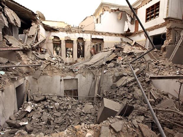 Alvo era o edifício do Conselho da Sociedade Civil, mas  atingiu uma escola para crianças com Síndrome de Down., que estava vazia. (Foto: AFP)