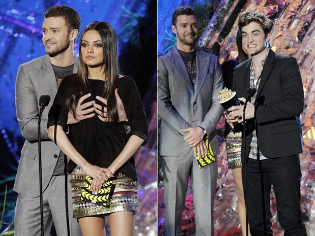 Justin Timberlake pega nos seios da atriz Mila Kunis e depois entrega a estatueta de melhor ator para Robert Pattinson neste domingo, no MTV Movie Awards, em Los Angeles (Foto: Reuters)