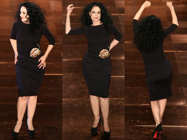 Sonia Braga quebra o protocolo das modelos e dança charmosa na passarela.  (Foto: Daigo Oliva/G1)