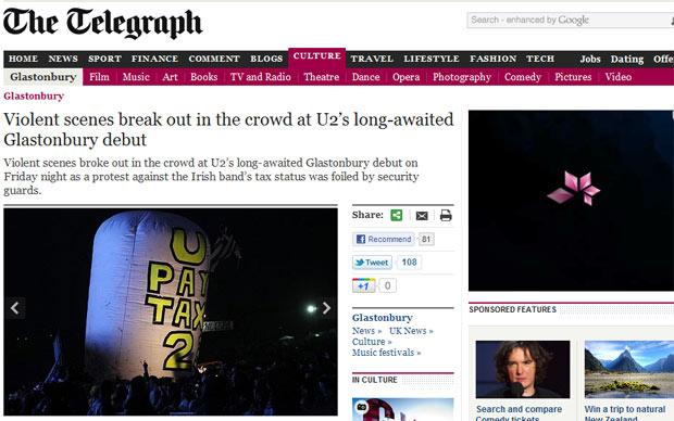 Foto do site do jornal 'Telegraph' mostra o momento em que manifestantes se preparavam para soltar balão no início do show do U2 (Foto: Reprodução)