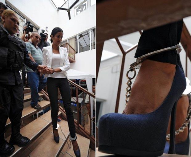 Ex-miss Honduras Bélgica Suárez foi algemada nos tornozelos e nos pulsos. (Foto: Orlando Sierra/AFP)