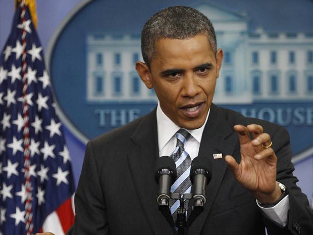 Obama responde perguntas durante entrevista coletiva na Casa Branca nesta sexta-feira. (Foto: Larry Downing/Reuters)