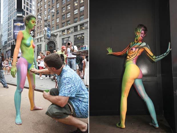 Andy Golub fez a aplicação de pintura corporal em modelo na Times Square. (Foto: Laurentiu Garofeanu/Barcroft USA/Getty Images)