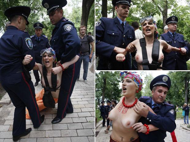 O protesto foi interrompido pelos policiais. Segundo as organizadoras, o ato era uma crítica simbolizando a maneira como o governo cortou a ajuda a famílias ucranianas necessitadas nos últimos 20 anos. (Foto: Vladimir Sindeyev/Reuters)