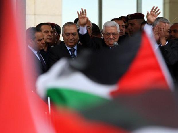Mahmoud Abbas é recebido com festa ao voltar para a Cisjordânia. (Foto: Abbas Momani / AFP Photo)