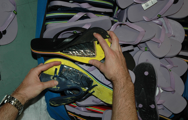 In this photo, Federal Police in Sao Paulo show sandals seized from another Angolan in that city trying to board a flight to Africa in October 2011.