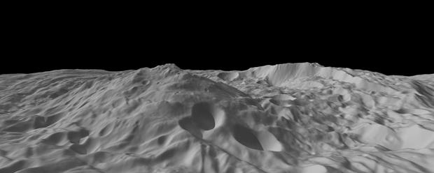 Superfície do asteroide Vesta apresenta grande formação montanhosa no centro da imagem. O pico chega a 22 quilômetros de altura. (Foto: Nasa / via AP Photo)