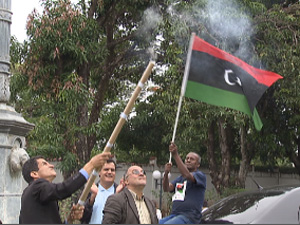 Libyan Embassy workers celebrate in Brasilia after announcement of Gaddafi (Kadhafi) death October 20, 2011. (photo: Globo network)