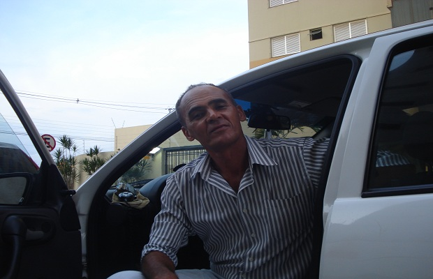 Taxi driver Aprigio Moreira pictured in his taxi cab on the streets of the capital, Goiania, Goias, Brazil. Today, 24 October is the 78th anniversary of the founding of Goiania.