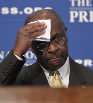 Herman Cain durante entrevista na segunda-feira (31) (Foto: AP)