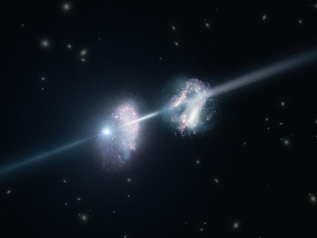 Imagem mostra como seria um feixe de raios gama cruzando as duas galáxias. (Foto: ESO)